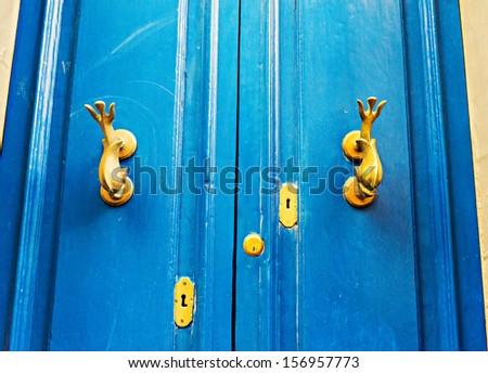 ancient door in a house in malta island - stock photo