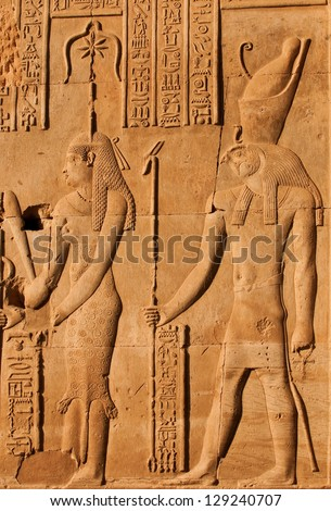Ancient Egyptian carvings and hieroglyphic depicting Thoth - stock photo