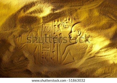 Ancient Egyptian hieroglyphs uncovered in the sandy desert - stock photo