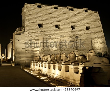 Ancient egyptian temple of Karnak in Luxor lit up at night during the sound and light show - stock photo