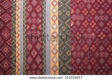 Ancient fabric colorful thai silk handcraft peruvian style rug surface close up textiles peruvian stripe beautiful background tapestry persian detail pattern farabic fashionable old cloth uneven color - stock photo