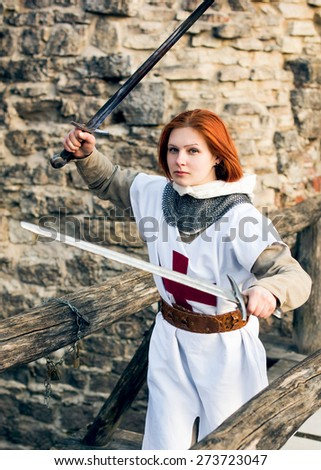Ancient female knight in metal armor - stock photo