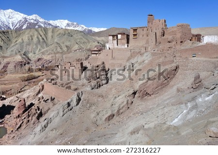 Ancient fortress and Buddhist Monastery (Gompa) in Basgo valley against the background of distant mountain and blue sky, Leh district, Ladakh, Jammu & Kashmir, Northern India - stock photo