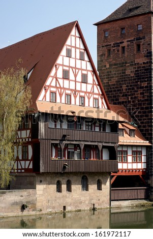 Ancient Franconian building at river Pegnitz in Nuremberg - stock photo