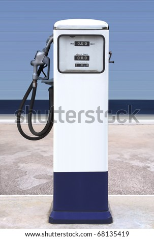 Ancient gas pump in the setting of an retro gas station - stock photo