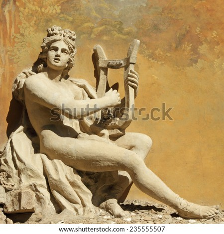 ancient god with the lire instrument -  decorative carving on wall, Florence - stock photo