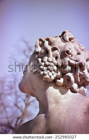 Ancient goddess of wine sculpture - stock photo