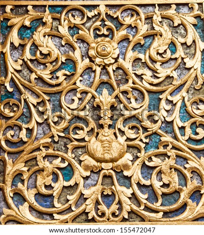 Ancient golden carving wooden window of Thai temple. Thailand - stock photo