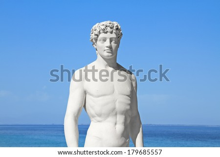 Ancient greek statue of a young athlete by the sea - stock photo