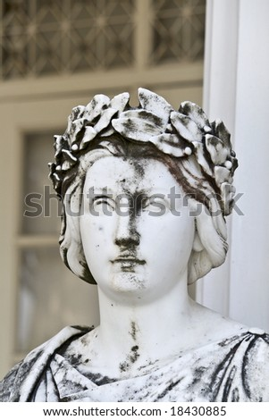 Ancient Greek statue outside of a temple. Achilleion palace, Corfu island, Greece - stock photo