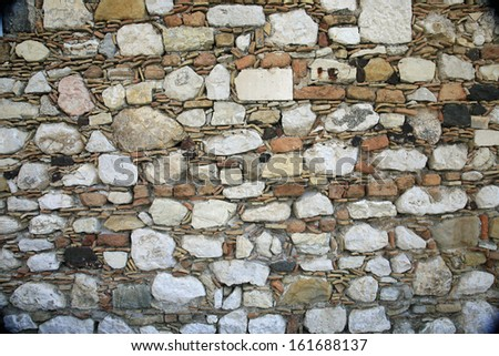 Ancient Greek Stone Wall Background - stock photo