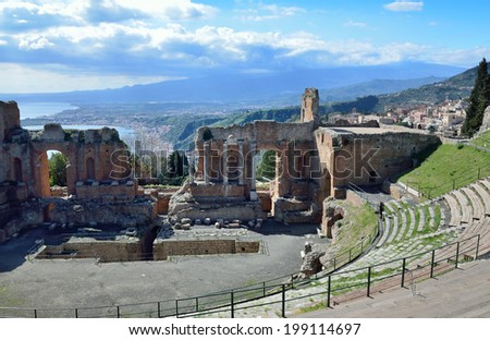 Ancient Greek theatre is the most remarkable monument remaining at Taormina. This is one of the most celebrated ruins in Sicily. - stock photo