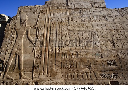 Ancient hieroglyphs on wall, Temple of Karnak, located at modern day Luxor or ancient Thebes, Egypt - stock photo