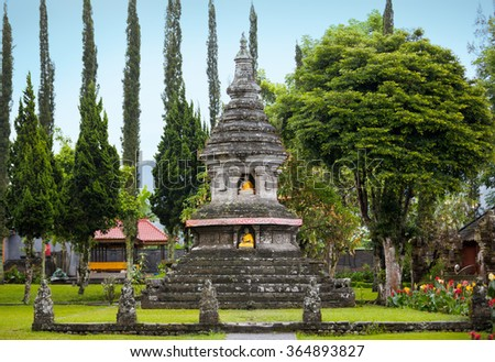 ancient Hindu temple surrounded by stone statues - stock photo