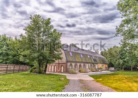 Ancient house in French countryside. - stock photo