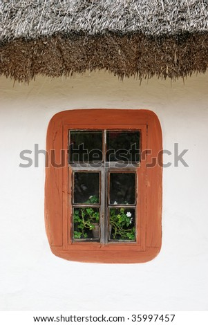Ancient house window - stock photo