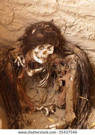 Ancient human remains with extensive hair braids or dreads from the Nazca culture at the Cemetery de Chauchilla. Nazca, Peru, South America. - stock photo