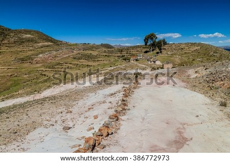 Ancient Inca trail on Isla del Sol (Island of the Sun) in Titicaca lake, Bolivia - stock photo