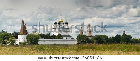 Ancient Iosifo-Volockiy monastery in Russia. Panoramic view with majestic sky. - stock photo