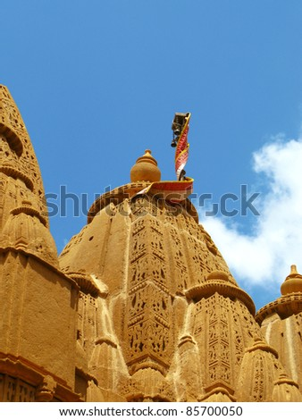 "Ancient jainist temple in Jaisalmer, the magnificent ""Golden City"" in the heart of Rajasthan (India), surrounded by the desert of Thar - stock photo"