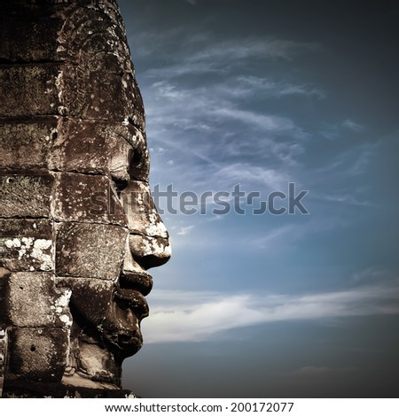 Ancient Khmer architecture. Huge carved Buddha faces of Bayon temple at Angkor Wat complex, Siem Reap, Cambodia - stock photo
