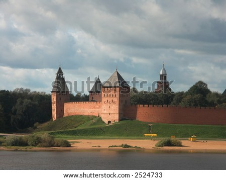 Ancient kremlin (fortress) near river in Novgorod, Russia made of red bricks - stock photo