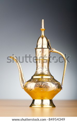 Ancient lamp against gradient background - stock photo
