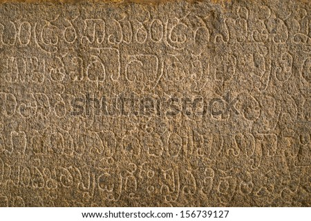ancient Language written on  Krishna temple, Hampi, Karnataka state, India - stock photo