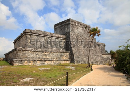 Ancient Maya stone temple at the caribbean cost of Tulum, Mexico  - stock photo