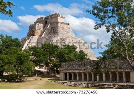 Ancient mayan pyramid (Maya Pyramid of the Magician, Adivino). Uxmal, Merida, Yucatan, Mexico - stock photo