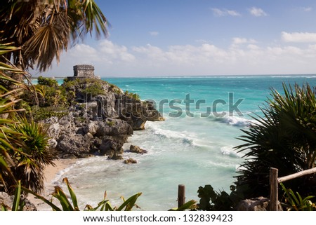 Ancient Mayan ruins in Tulum on the beach of Caribbean turquoise sea - stock photo