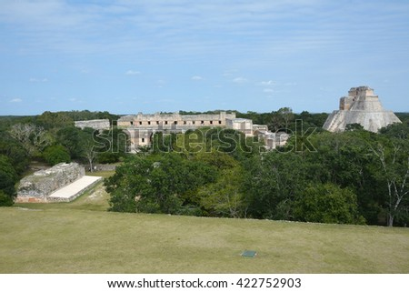 Ancient Mayan site Uxmal, Mexico. The Pyramid of the Magician and nunnery building in Uxmal, Yucatan Peninsula, Mexico. View from Governor's Palace.  - stock photo