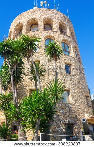 Ancient medieval tower at the entrance to the famous marina of Puerto Banus, Malaga, Spain - stock photo