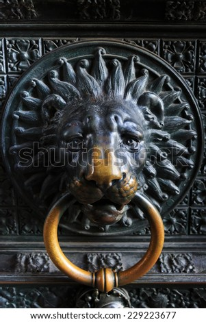 Ancient metal lion head on the door to catholic church in Cologne, Germany  - stock photo