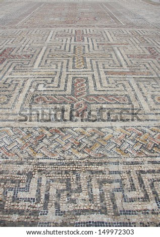 Ancient mosaic in the Roman ruins of Conimbriga, Portugal. 1st to 2nd centuries. - stock photo