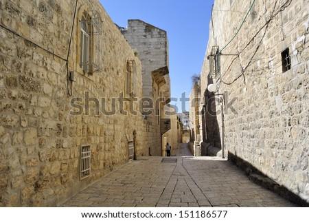 Ancient narrow street in Old City of Jerusalem, Israel. - stock photo