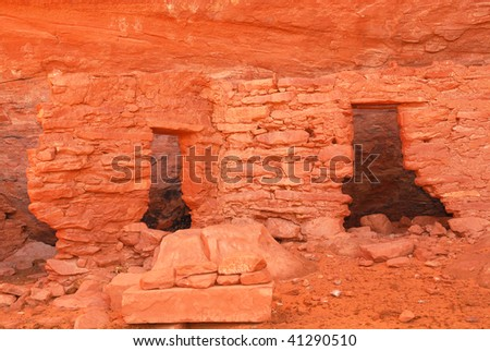 Ancient Navajo Anasazi dwelling with pictographs in Mystery Valley - stock photo