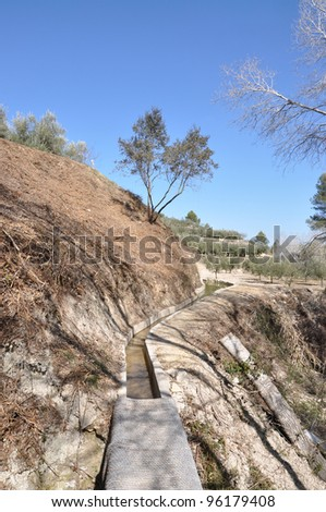 "Ancient old aqueduct (irrigation system) built by arabs in the ""camins de l'aigua"" area of Carricola, a small town in the province of Valencia Spain Europe - stock photo"