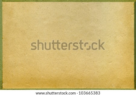 ancient old paper background in a frame - stock photo