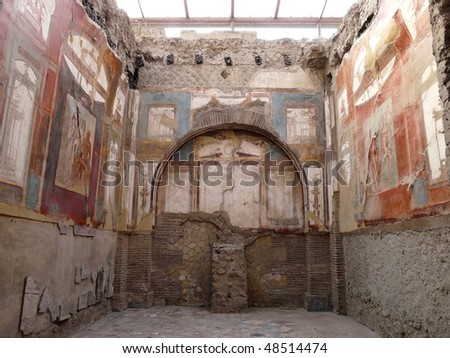 Ancient painted wall frescos at the ancient Roman city of Herculaneum, which was destroyed and buried during the eruption of Mount Vesuvius in 79 AD - stock photo