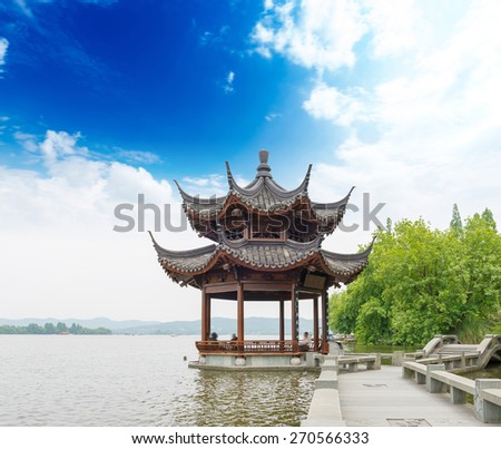ancient pavilion on the west lake in hangzhou,China - stock photo