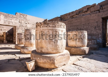 Ancient pieces inside the  Medinet Habu (Mortuary Temple of Ramesses III), West Bank of Luxor in Egypt. - stock photo