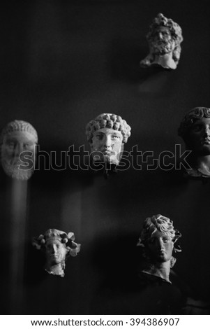 Ancient portrait carvings made out of stone - stock photo