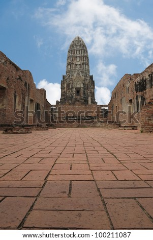 ancient prang in Ayutthaya, with blue sky - stock photo