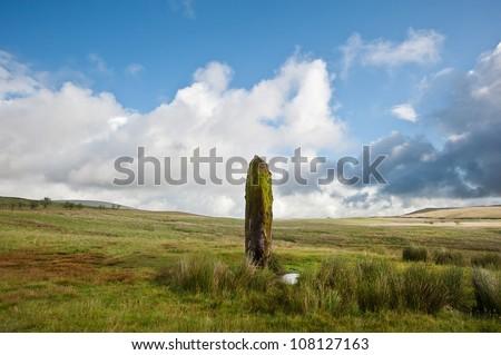 Ancient prehistoric stone in landscape - stock photo