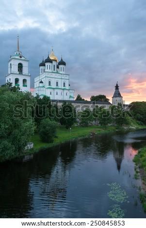 Ancient Pskov Krom at sunset on Velikaya river, Russia - stock photo