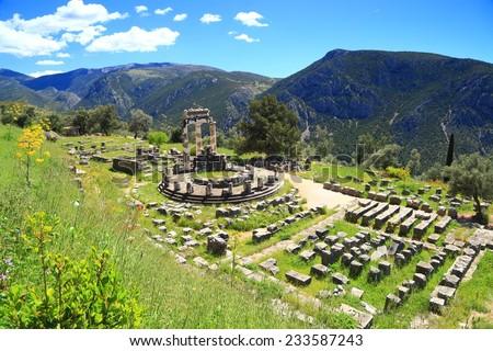 Ancient remains of a circular temple dedicated to goddess Athena at Delphi, Greece - stock photo