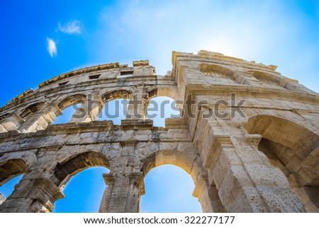 Ancient Roman Amphitheater in Pula, Croatia. Famous tourist destination. - stock photo