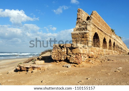 Ancient Roman aqueduct at Ceasarea along the coast of the Mediterranean Sea, Israel. - stock photo