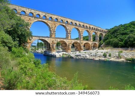 Ancient Roman aqueduct of Pont du Gard near Nimes, France - stock photo